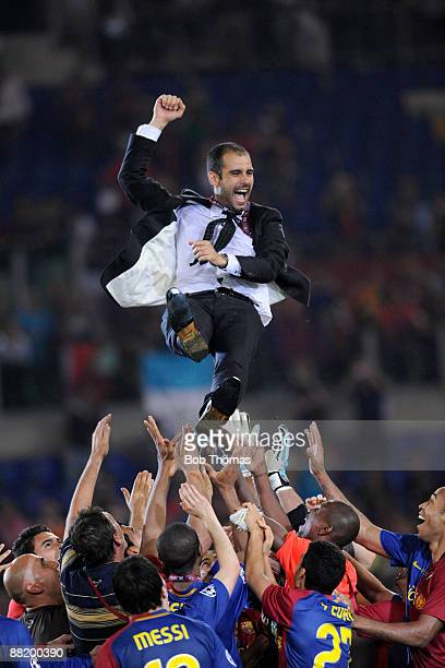Barcelona coach Josep Guardiola is thrown into the air by the Barcelona players after the UEFA Champions League Final match between Barcelona and...