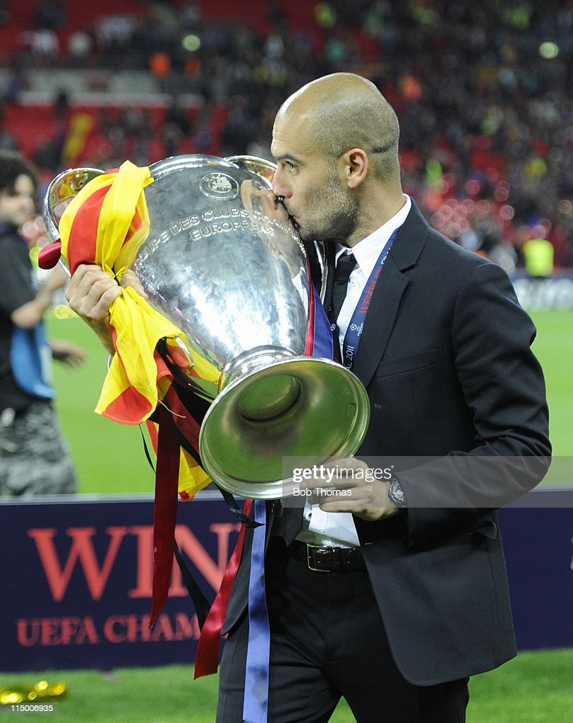 Barcelona coach Josep Guardiola kissing the trophy after the UEFA Champions League final between FC Barcelona and Manchester United FC at Wembley Stadium on May 28, 2011 in London, England. Barcelona won the match 3-1.
