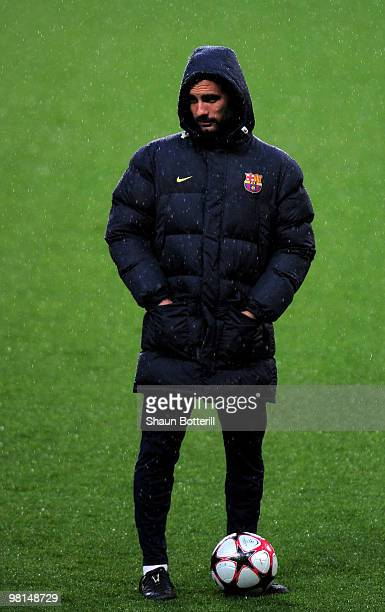 Barcelona coach Josep Guardiola looks on during a training session ahead of their UEFA Champions League quarter final first leg match against Arsenal...