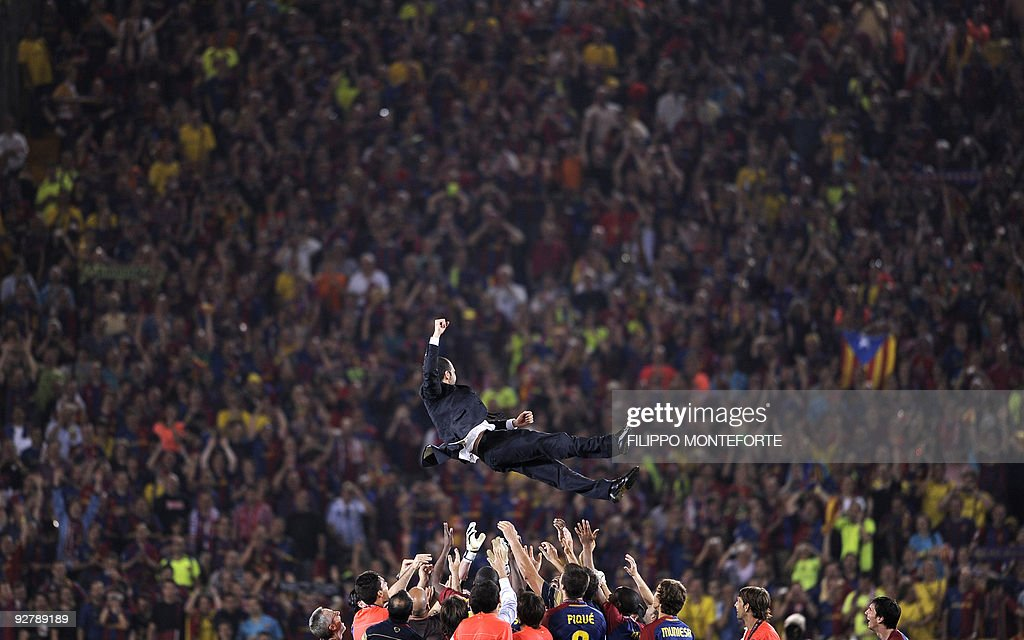 Barcelona coach Pep Guardiola is thrown : News Photo