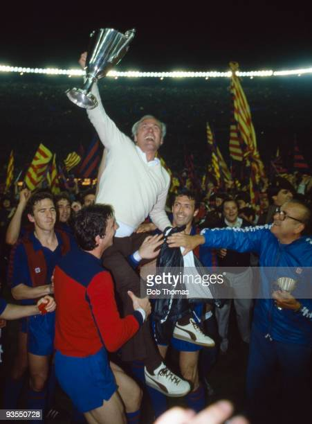 Barcelona coach Udo Lattek holding the Cup Winners Cup is carried by his players after the European Cup Winners Cup Final against Standard Liege...