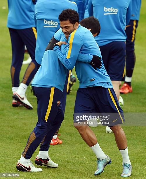 FC Barcelona defender Dani Alves jokes with an unidentified teammate during their training session at the Club World Cup football tournament in...