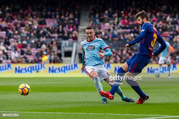 FC Barcelona defender Gerard Pique and Celta de Vigo forward Iago Aspas during the match between FC Barcelona vs Celta de Vigo for the round 14 of...