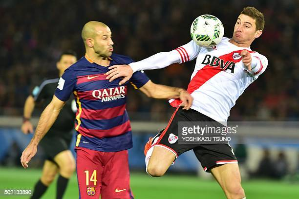 Barcelona defender Javier Mascherano and River Plate forward Lucas Alario compete for the ball during the Club World Cup football final in Yokohama...
