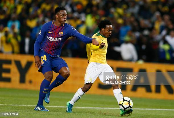 Barcelona defender Yerry Minais tackles Mamelodi Sundown forward Percy Tau during their friendly match Barcelona vs Sundowns for the Mandela...