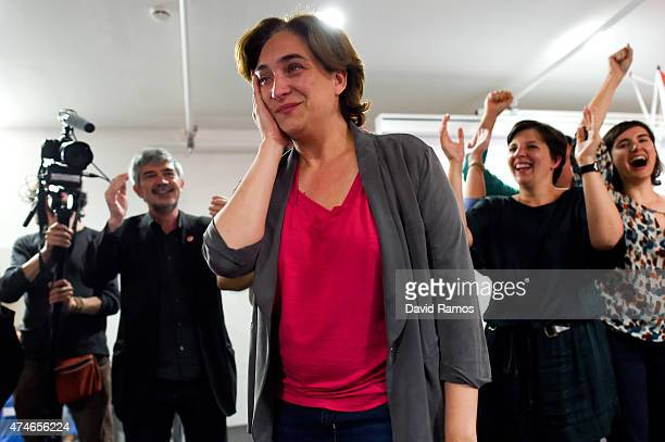 'Barcelona en Comu' leader Ada Colau tears up with wellwishers after her party won the municipal elections on May 24 2015 in Barcelona Spain...