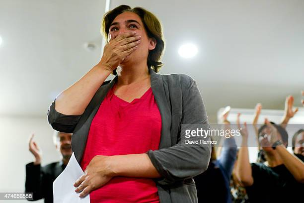 Barcelona en Comu' leader Ada Colau tears up with wellwishers after her party won the municipal elections on May 24, 2015 in Barcelona, Spain....