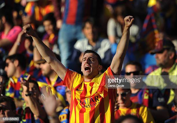 Barcelona fan cheers for his team ahead of the Copa del Rey Final between Barcelona and Sevilla at Vicente Calderon Stadium on May 22 2016 in Madrid...