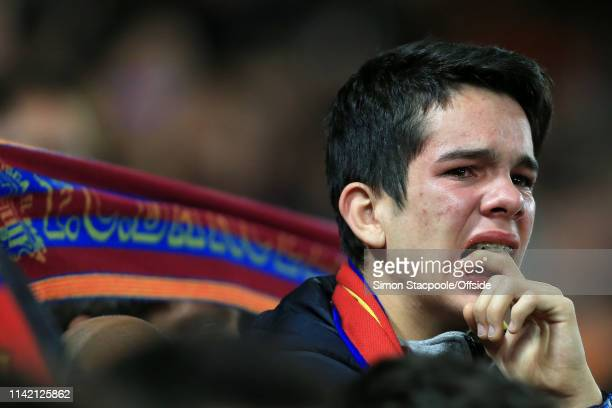 Barcelona fan cries following his side's loss in the UEFA Champions League Semi Final second leg match between Liverpool and FC Barcelona at Anfield...