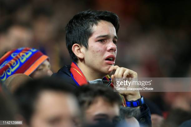 Barcelona fan looks beside himself after his side's loss in the UEFA Champions League Semi Final second leg match between Liverpool and FC Barcelona...