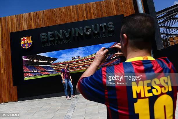 Barcelona fan poses for a picture in front a Camp Nou stadium picture prior to the La Liga match between FC Barcelona and Club Atletico de Madrid at...