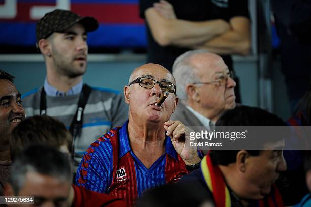 Barcelona fan smokes a cigar during the La Liga match between FC Barcelona and Real Racing Club at Camp Nou on October 15, 2011 in Barcelona, Spain....