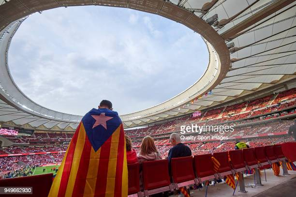 Barcelona fan waves a Estelada flag prior to the Spanish Copa del Rey Final match between Barcelona and Sevilla at Wanda Metropolitano on April 21...