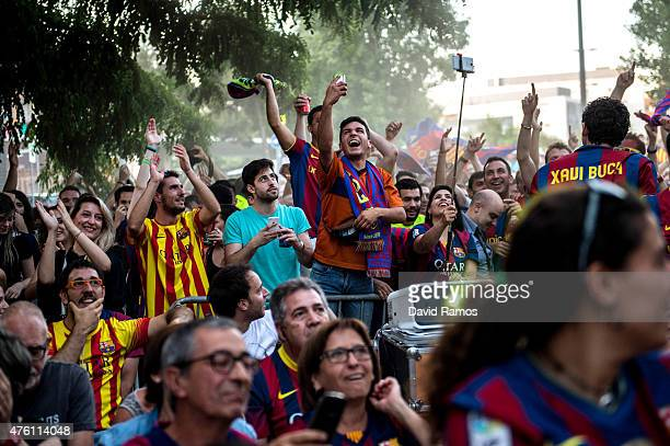 Barcelona fans celebrate the FC Barcelona opening goal as they watch the UEFA Champions League Final match on a big screen on June 6 2015 in...