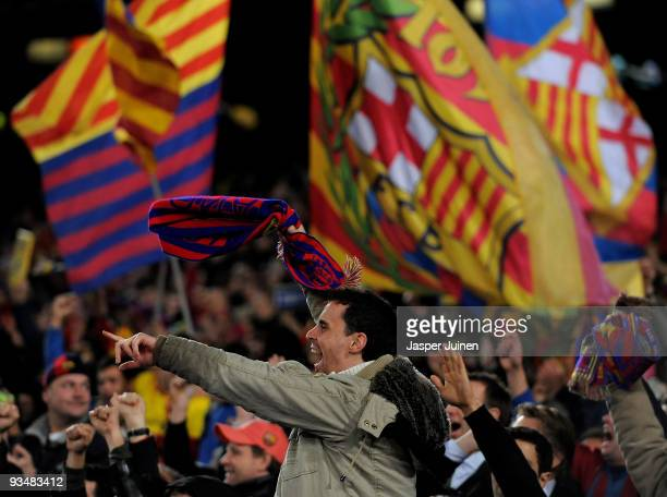 Barcelona fans celebrate their teams victory during the La Liga match between Barcelona and Real Madrid at the Camp Nou Stadium on November 29 2009...