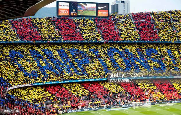 TOPSHOT Barcelona fans create a mosaic reading 'champions' in Catalan before the Spanish league football match between FC Barcelona and Real Madrid...