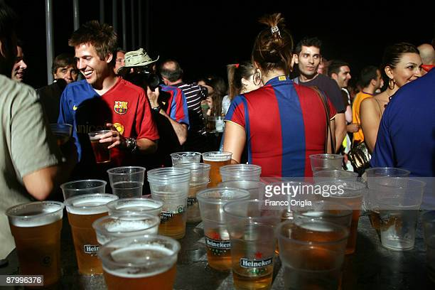 Barcelona fans drink beer in an open pub ahead of the UEFA Champions League Final between Barcelona and and Manchester United at the Stadio Olimpico...