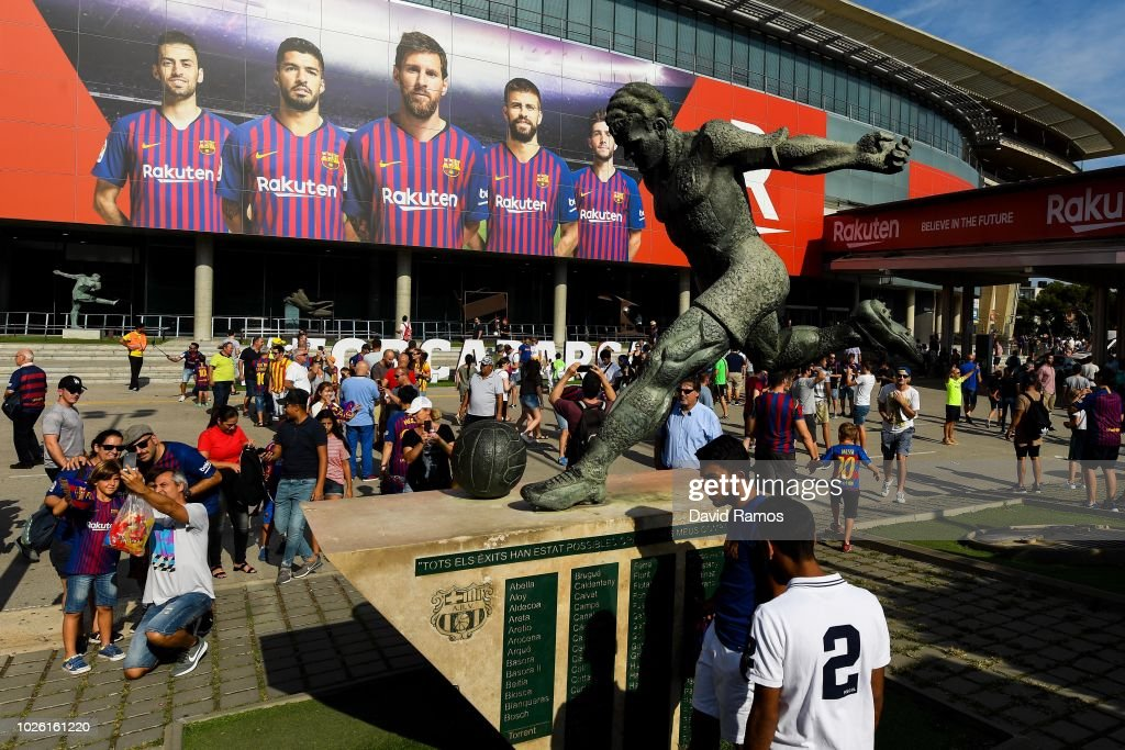 FC Barcelona fans enjoy the atmosphere outside the stadium prior to the La Liga match between FC Barcelona and SD Huesca at Camp Nou on September 2, 2018 in Barcelona, Spain.