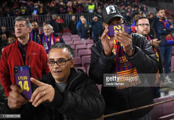 Barcelona fans enjoy the atmosphere prior to the UEFA Champions League Round of 16 Second Leg match between FC Barcelona and Olympique Lyonnais at...