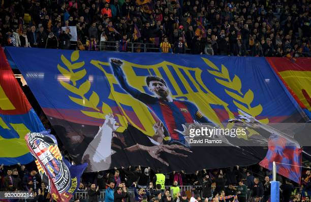 Barcelona fans hold a Lionel Messi banner prior to the UEFA Champions League Round of 16 Second Leg match FC Barcelona and Chelsea FC at Camp Nou on...