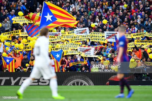 Barcelona fans hold up banners demanding freedom during the Spanish league football match between FC Barcelona and Real Madrid CF at the Camp Nou...