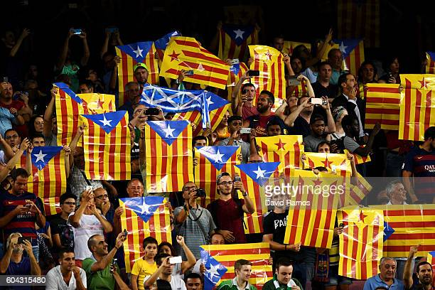 Barcelona fans hold up ProCatalan Independence flags prior to the UEFA Champions League Group C match between FC Barcelona and Celtic FC at Camp Nou...