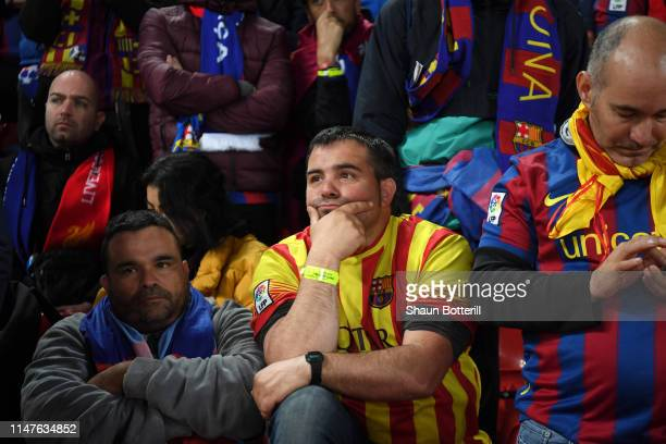 Barcelona fans look dejected in defeat after the UEFA Champions League Semi Final second leg match between Liverpool and Barcelona at Anfield on May...