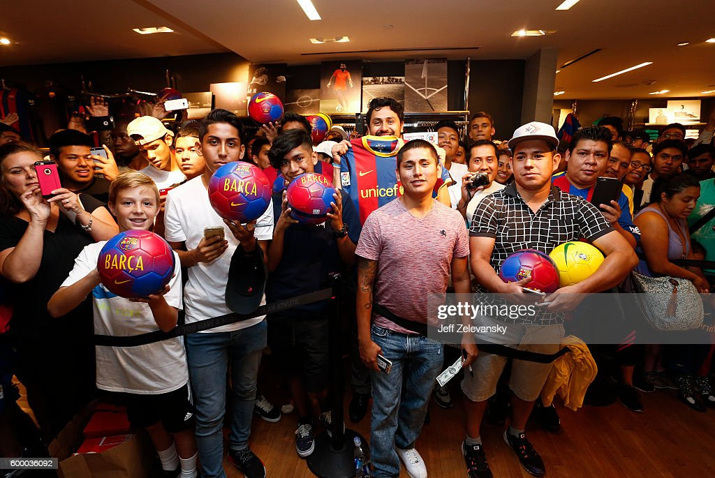 FC Barcelona fans pose for pictures at Niketown to celebrate the Club's arrival to New York on September 7, 2016 in New York City.