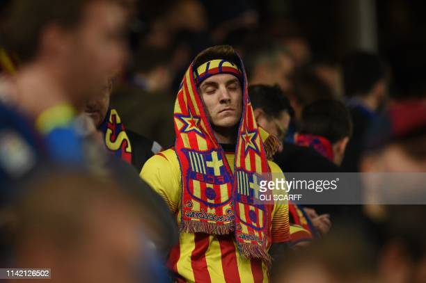 Barcelona fans react after losing 4-0 after the UEFA Champions league semi-final second leg football match between Liverpool and Barcelona at Anfield...