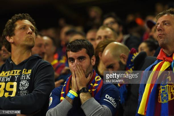 Barcelona fans react during the UEFA Champions league semifinal second leg football match between Liverpool and Barcelona at Anfield in Liverpool...