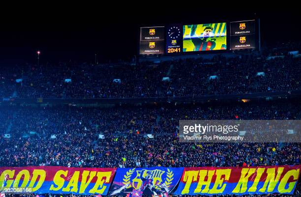 Barcelona fans roll out a giant banner saying 'God save the King' and a picture of Barcelona superstar Lionel Messi prior to the UEFA Champions...