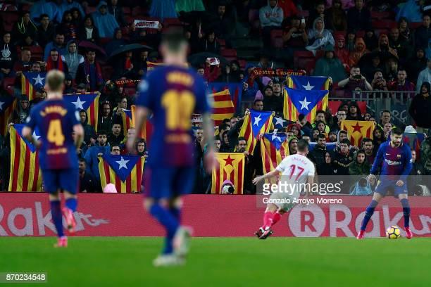 Barcelona fans show Estelada flags during the La Liga match between FC Barcelona and Sevilla FC at Camp Nou stadium on November 4 2017 in Barcelona...
