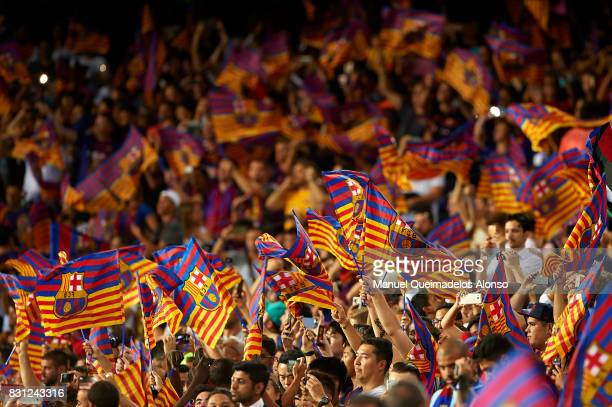 Barcelona fans suport their team during a warm up prior to the Supercopa de Espana Supercopa Final 1st Leg match between FC Barcelona and Real Madrid...
