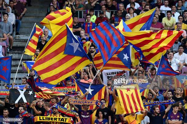 Barcelona fans wave Catalan independence flags during the Group B match of the UEFA Champions League between FC Barcelona and PSV at Camp Nou on...