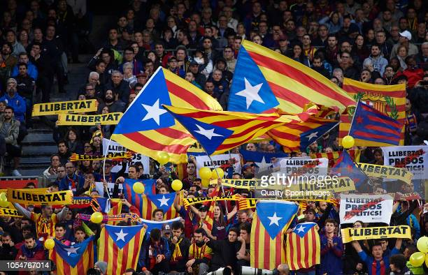 Barcelona fans wave Catalan independence flags during the La Liga match between FC Barcelona and Real Madrid CF at Camp Nou on October 28 2018 in...
