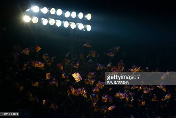 Barcelona fans wave flags before the UEFA Champions League round of sixteen second leg football match between FC Barcelona and Chelsea FC at the Camp...