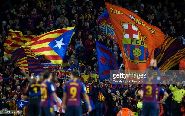 Barcelona fans wave flags of the Catalan independence during the La Liga match between FC Barcelona and Real Madrid CF at Camp Nou on October 28 2018...