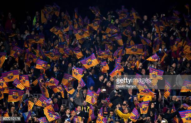 Barcelona fans wave flags prior to the UEFA Champions League Round of 16 Second Leg match FC Barcelona and Chelsea FC at Camp Nou on March 14 2018 in...