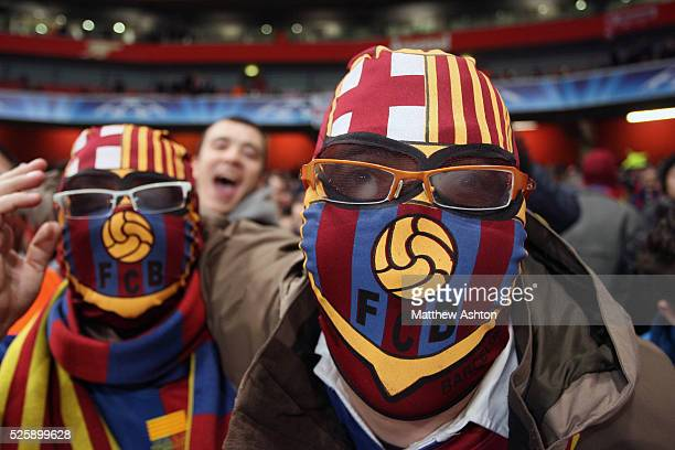 FC Barcelona fans wear wrestling masks with the club crest on