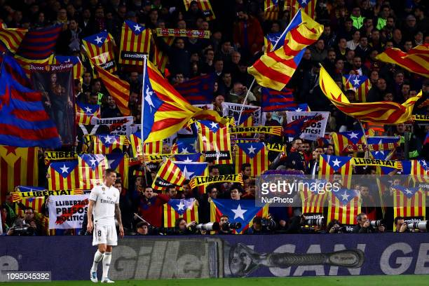 FC Barcelona fans with esteladas flags during semifinal of spanish King Cup frist leg match between FC Barcelona and Real Madrid at Nou Camp Stadium...