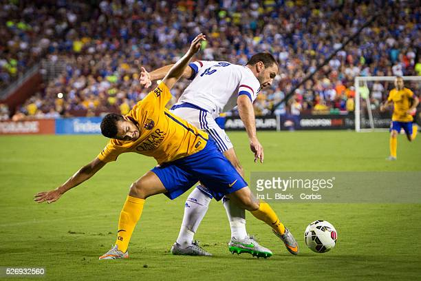 Barcelona FC player Pedro fights for control against Chelsea FC player Branislav Ivanovic during the Soccer 2015 Guinness International Champions Cup...