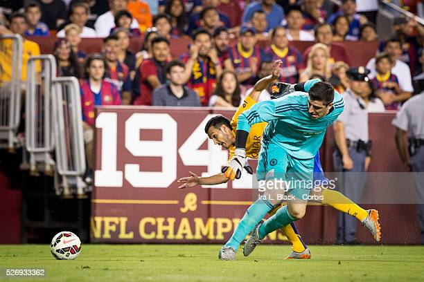 Barcelona FC player Pedro tries to drive past Chelsea FC goalkeeper Thibaut Courtois during the Soccer 2015 Guinness International Champions Cup...
