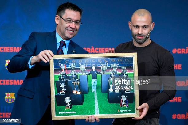 Barcelona FC president Josep Maria Bartomeu and Barcelona's Argentinian defender Javier Mascherano pose with a framed picture of Mascherano and the...