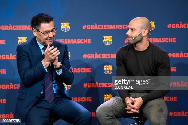 Barcelona FC president Josep Maria Bartomeu applauds next to Barcelona's Argentinian defender Javier Mascherano during a farewell ceremony organised...