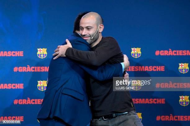 Barcelona FC president Josep Maria Bartomeu hugs Barcelona's Argentinian defender Javier Mascherano during a farewell ceremony organised by the...
