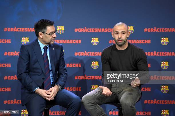 Barcelona FC president Josep Maria Bartomeu listens to Barcelona's Argentinian defender Javier Mascherano during a farewell ceremony organised by the...