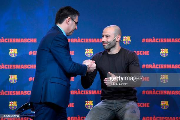 Barcelona FC president Josep Maria Bartomeu shakes hands with Barcelona's Argentinian defender Javier Mascherano during a farewell ceremony organised...