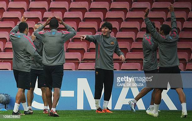 Barcelona FC's Argentinian striker Lionel Messi takes part in a training session at the Nou Camp stadium on March 7 2011 Barcelona were training of...