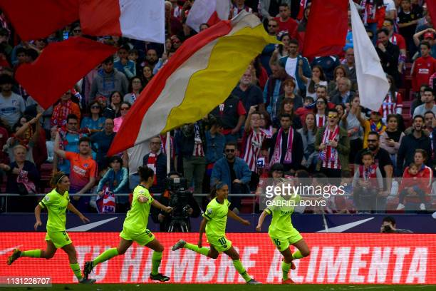 Barcelona FC's forward Toni Duggan celebrates her goal with teammates during the Spanish league football match between Club Atletico de Madrid and FC...