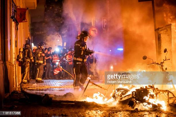 Barcelona firefighters put out fires during protests on October 16 2019 in Barcelona Spain Earlier in the week the Spanish Supreme Court sentenced...